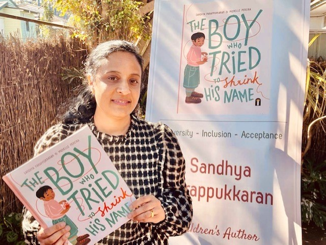 Debut picture book author Sandhya Parappukkaran with her book THE BOY WHO TRIED TO SHRINK HIS NAME.