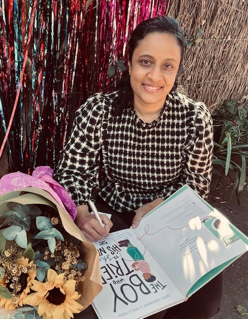 Debut picture book author Sandhya Parappukaran signing her book.